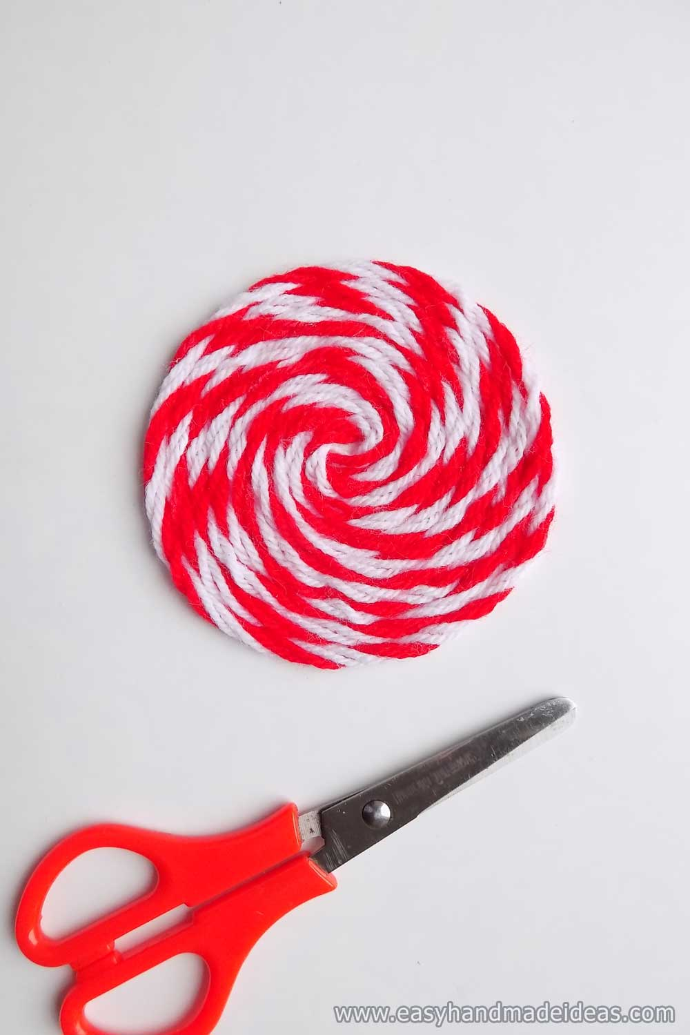 The Circle of Yarn on the Cut Paper